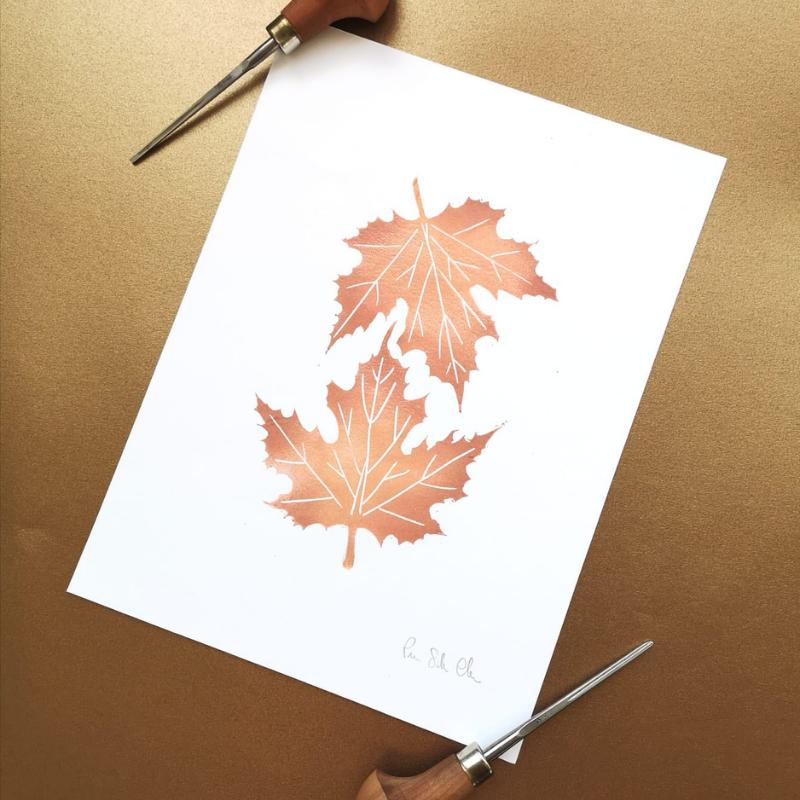 stampa autunnale fall linoleografia con due foglie d'acero autunnali